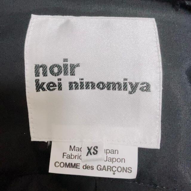 COMME des GARCONS(コムデギャルソン)の【新品】noir kei ninomiya ベルトプリーツブラウス ブラック レディースのトップス(シャツ/ブラウス(長袖/七分))の商品写真