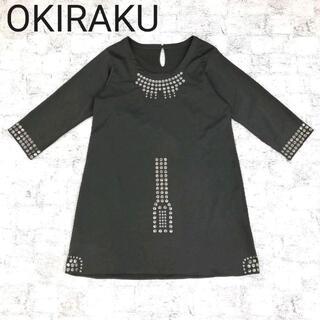 オキラク(OKIRAKU)のOKIRAKU オキラク 七分袖スタッズ付きワンピース(ひざ丈ワンピース)