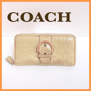 コーチ(COACH)の コーチ ラウンドファスナー エンボスド パテント バックル ジップアラウンド(長財布)
