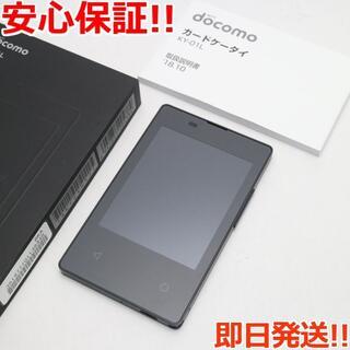 キョウセラ(京セラ)の美品 SIMロック解除済 KY-01L カードケータイ ブラック (携帯電話本体)
