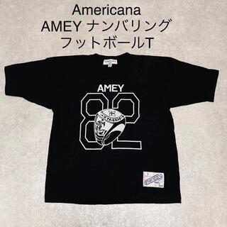 アメリカーナ(AMERICANA)のAmericana AMEY ロゴ フットボール ナンバリング Tシャツ 黒(Tシャツ(半袖/袖なし))