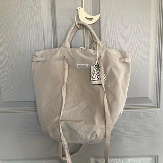ヤエカ(YAECA)のオールドマンズテーラー ガーメントダイドローストリングバッグ サンドベージュ(トートバッグ)