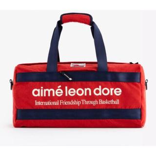 ニューバランス(New Balance)のaime leon dore new balance duffle bag 赤(ボストンバッグ)