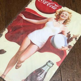 コカコーラ(コカ・コーラ)のコカコーラ ピンアップガール ワンピース水着 ブリキ看板(ソフトドリンク)