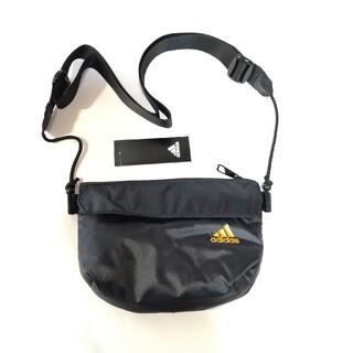 アディダス(adidas)のアディダス:ポーチ:ショルダーストラップ付き:黒/オレンジロゴ(ボディバッグ/ウエストポーチ)