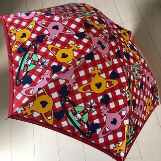 ヴィヴィアンウエストウッド(Vivienne Westwood)のヴィヴィアンウエストウッド 軽量折り畳み傘 美品/赤 チェック オーブ スカル(傘)