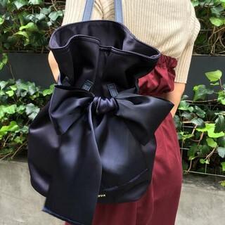 メゾンドフルール(Maison de FLEUR)の【未使用】メゾンドフルール  巾着 リボン リュック ネイビー(リュック/バックパック)