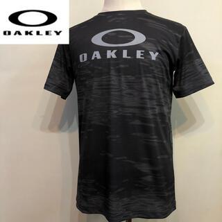オークリー(Oakley)のオークリー スポーツシャツ TEE  Tシャツ ブラック 総柄  Lサイズ (トレーニング用品)