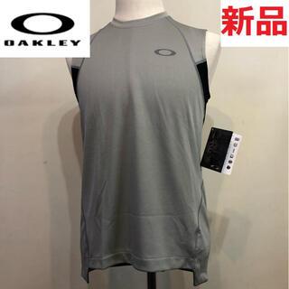 オークリー(Oakley)の新品未使用 オークリー スポーツ タンクトップ 海外モデル グレー Mサイズ (ウェア)