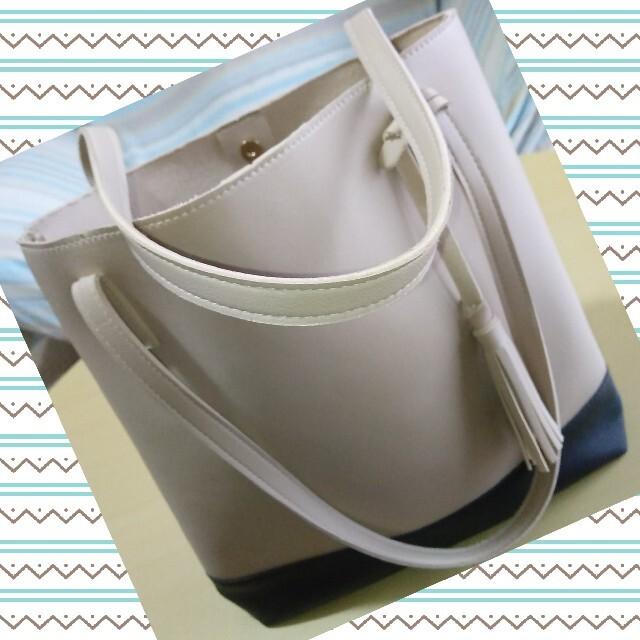 COACH(コーチ)のフリンジ付き ベージュ&ブラック バイカラー モノトーン ツートンカラー ハンド レディースのバッグ(ハンドバッグ)の商品写真