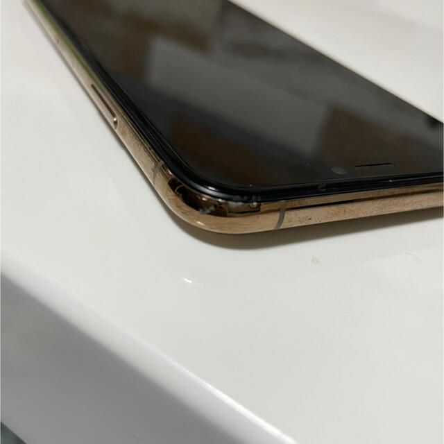 Apple(アップル)のiPhone XS 64GB  ゴールド スマホ/家電/カメラのスマートフォン/携帯電話(スマートフォン本体)の商品写真