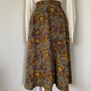 グリモワール(Grimoire)の古着《アースカラーのローズ柄フレアスカート》くすみカラー ヴィンテージ レトロ(ロングスカート)
