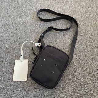 マルタンマルジェラ(Maison Martin Margiela)のユニセックスメッセンジャーバッグ(メッセンジャーバッグ)