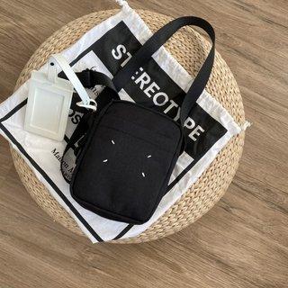 マルタンマルジェラ(Maison Martin Margiela)のクロスボディキャンバスバッグ(メッセンジャーバッグ)