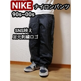 ナイキ(NIKE)のNIKE ナイキ ナイロンパンツ ワイドパンツ ブラック 黒 バギーパンツ L(サルエルパンツ)