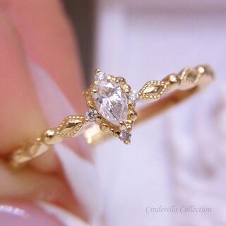 大特価★K18YG天然ダイヤモンド★お星様のミル打ちペアシェイプリング