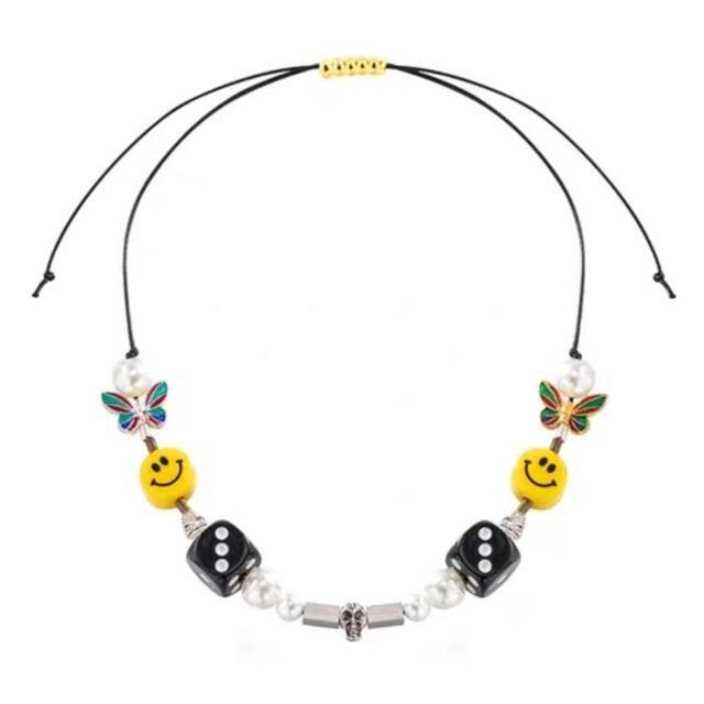 ニコちゃん スマイルネックレス 2本セット蝶 サイコロ ドクロ メンズのアクセサリー(ネックレス)の商品写真