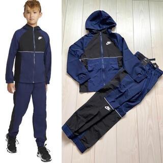 ナイキ(NIKE)の新品 NIKE ウーブン トラックスーツ 男の子 ネイビー 140 セットアップ(ジャケット/上着)