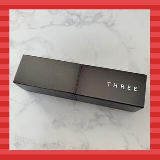 スリー(THREE)のTHREE ラッシュペルシードリップスティック X02 SUNKISSABLE(口紅)