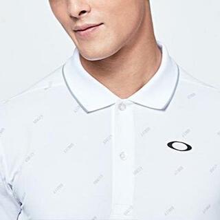 オークリー(Oakley)の(新品)OAKLEY ロゴ総柄 ポロシャツ (ポロシャツ)