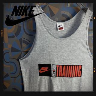 ナイキ(NIKE)のナイキ 90s タンクトップ クロストレーニング オレンジ グレー(タンクトップ)
