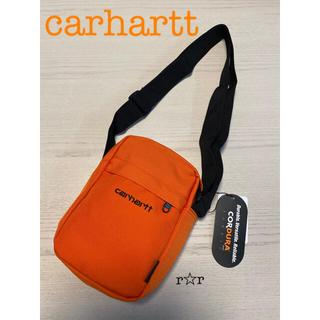 カーハート(carhartt)のカーハート ペイトン ショルダーポーチ オレンジ(ショルダーバッグ)