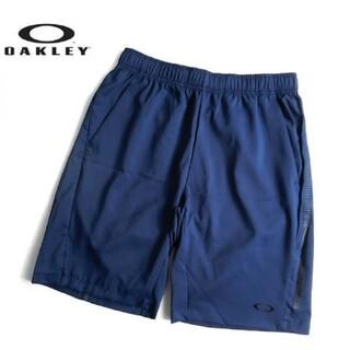オークリー(Oakley)の新品 OAKLEY オークリー クロスショートパンツ スポーツウェア 紺 M(ウェア)