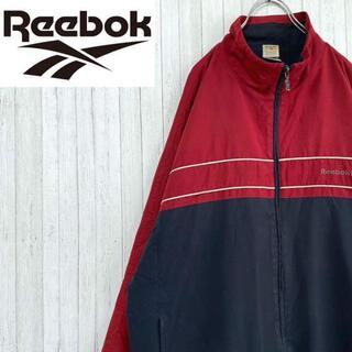 リーボック(Reebok)のリーボック ナイロンジャケット 刺繍ロゴ ジップアップ 万国旗タグ L(ナイロンジャケット)