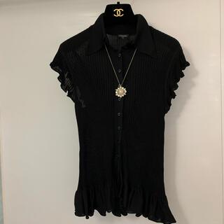 シャネル(CHANEL)の【美品】可愛い♡ CHANEL フレアが素敵なブラックニット(シャツ/ブラウス(半袖/袖なし))