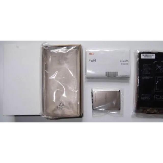 LG Electronics(エルジーエレクトロニクス)のau Fx0 未使用 スマホ/家電/カメラのスマートフォン/携帯電話(スマートフォン本体)の商品写真