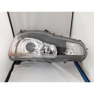 ミツビシ(三菱)の三菱 ランサー CBA-CZ4A-SMGFZ 純正 ヘッドランプ 左(車種別パーツ)
