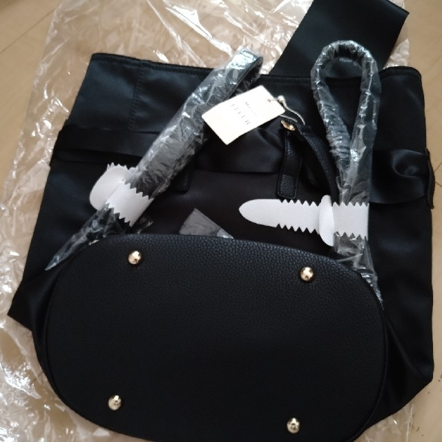Maison de FLEUR(メゾンドフルール)の新品 メゾンドフルール リボンリュック 黒 レディースのバッグ(リュック/バックパック)の商品写真