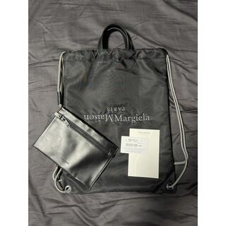 マルタンマルジェラ(Maison Martin Margiela)のMAISON MARGIELA ドローストリング バックパック ブラック(バッグパック/リュック)