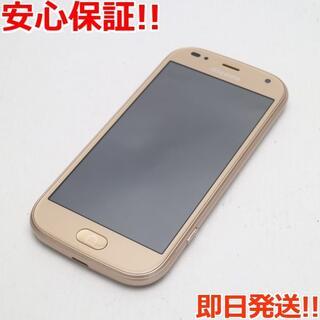 フジツウ(富士通)の新品同様 F-01L らくらくスマートフォン me ゴールド (スマートフォン本体)