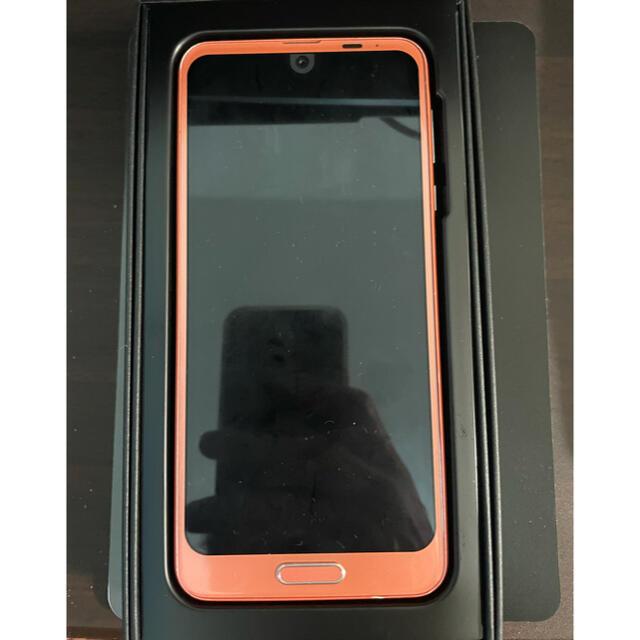 AQUOS(アクオス)のAQUOS SH-03K コーラルピンク SIMフリー 6.0インチ スマホ スマホ/家電/カメラのスマートフォン/携帯電話(スマートフォン本体)の商品写真