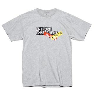 ユニフォームエクスペリメント(uniform experiment)のユニフォームエクスペリメント UE ATTENTION TAG TEE(Tシャツ/カットソー(半袖/袖なし))