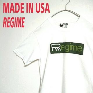 アートヴィンテージ(ART VINTAGE)のUSA製 REGIME VINTAGE アートデザイン 白 Tシャツ 古着(Tシャツ/カットソー(半袖/袖なし))