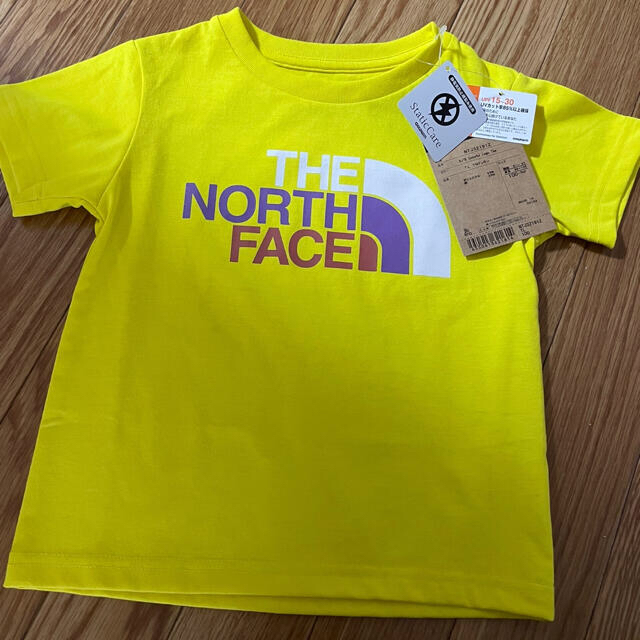 THE NORTH FACE(ザノースフェイス)のザノースフェイス Tシャツ トップス 新品 100  イエロー 男女兼用 キッズ/ベビー/マタニティのキッズ服男の子用(90cm~)(Tシャツ/カットソー)の商品写真