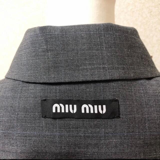 miumiu(ミュウミュウ)のmiumiu♡チェック ロゴ フリル  コート レディースのジャケット/アウター(ロングコート)の商品写真