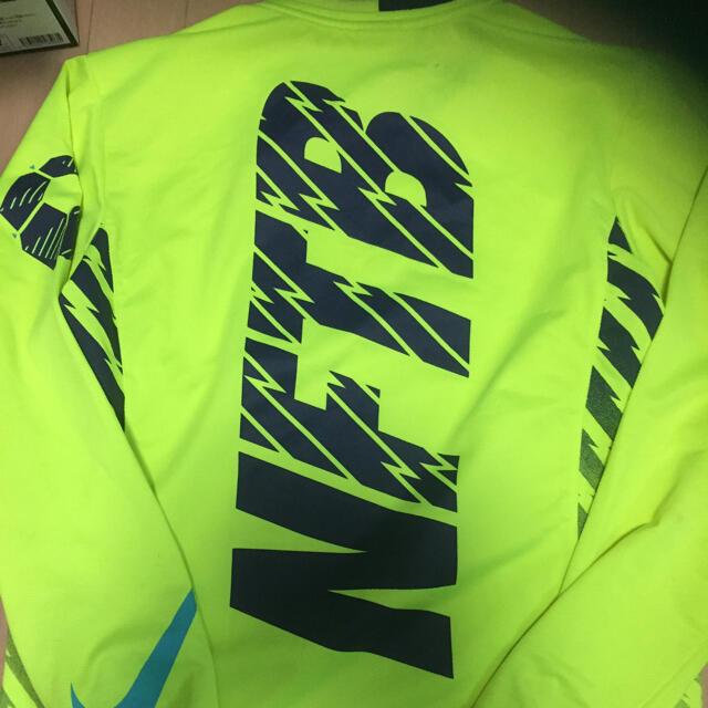 NIKE(ナイキ)の送料無料NikeナイキフットボールNFTBプラクティス蛍光イエロー スポーツ/アウトドアのサッカー/フットサル(ウェア)の商品写真