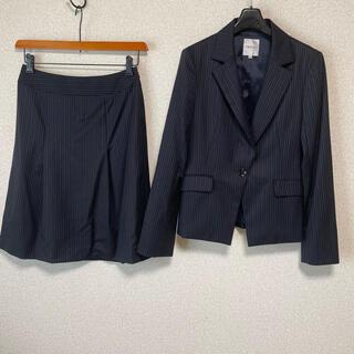 インディヴィ(INDIVI)のインディヴィ スカートスーツ 40 W66 黒 未使用に近い OL DMW(スーツ)