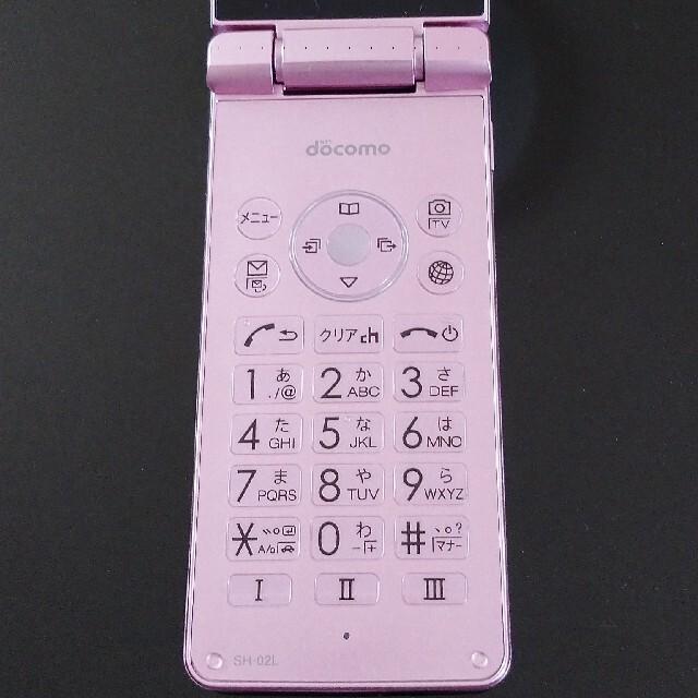 SHARP(シャープ)のほぼ新品 AQUOS ケータイ SH-02L ピンク docomo アダプター付 スマホ/家電/カメラのスマートフォン/携帯電話(携帯電話本体)の商品写真