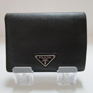 PRADA - プラダの折りたたみ財布 二つ折り 黒 三角プレート ユニセックス