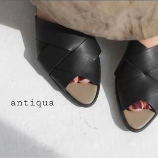 アンティカ(antiqua)の【antiqua】人気完売品 クロスデザインサンダル ブラック(サンダル)