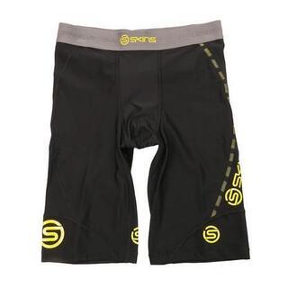SKINS - 新品 XSサイズ スキンズ DNAMIC ハーフタイツ 黒x黄色