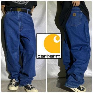 カーハート(carhartt)のCarhartt カーハート 革ロゴ ストレート デニムパンツ 濃紺 インディゴ(デニム/ジーンズ)