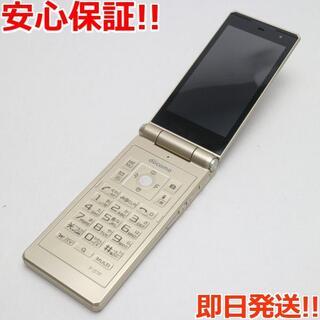 フジツウ(富士通)の良品中古 F-07F ゴールド 白ロム(携帯電話本体)