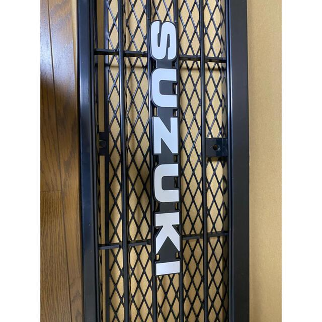 スズキ(スズキ)のスズキ 純正 ジムニー JA11 1型 SUZUKI エンブレム ナット付  自動車/バイクの自動車(車外アクセサリ)の商品写真