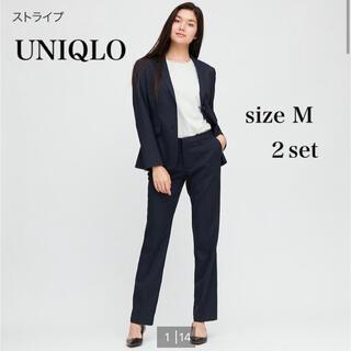 ユニクロ(UNIQLO)のUNIQLO ユニクロ パンツスーツ セットアップ 紺 ストライプ(スーツ)