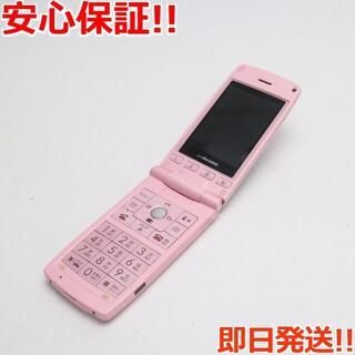 エルジーエレクトロニクス(LG Electronics)の美品 L-03A ライトピンク 白ロム(携帯電話本体)
